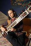 Aaron Hermes plays the sitar at the Arts of India Gallery launch party at the Museum of Fine Arts Houston Thursday May 14,2009.(Dave Rossman/For the Chronicle)