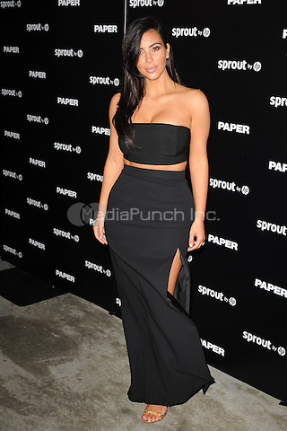 MIAMI BEACH, FL - DECEMBER 4:  Kim Kardashian attends Paper Magazine, Sprout By HP & DKNY Break The Internet Issue Release at 1111 Lincoln Road on December 4, 2014 in Miami, Florida. Credit: mpi04/MediaPunch