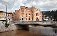 The National and University Library of Bosnia and Herzegovina, the national library, designed in 1891 by the Czech architect Karel Parik as the City Hall, and reopened as a library in 2014, Sarajevo, Bosnia and Herzegovina. This building, on the banks of the Miljacka river, is from the Austro-Hungarian period of the city. The building and many of its documents were damaged in 1992 during the Siege of Sarajevo in the Yugoslav War. Picture by Manuel Cohen