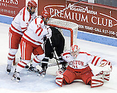Max Nicastro (BU - 7) and Garrett Noonan (BU - 13) push Derek Army (PC - 19) into the net after the whistle. - The Boston University Terriers defeated the visiting Providence College Friars 6-1 on Friday, January 20, 2012, at Agganis Arena in Boston, Massachusetts.