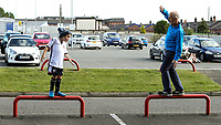 A young Bolton Wanderers supporters plays a balancing game with his grandfather before the match<br /> <br /> Photographer Andrew Kearns/CameraSport<br /> <br /> The Carabao Cup - Crewe Alexandra v Bolton Wanderers - Wednesday 9th August 2017 - Alexandra Stadium - Crewe<br />  <br /> World Copyright &copy; 2017 CameraSport. All rights reserved. 43 Linden Ave. Countesthorpe. Leicester. England. LE8 5PG - Tel: +44 (0) 116 277 4147 - admin@camerasport.com - www.camerasport.com