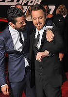 Aaron Paul &amp; Dominic Cooper (left) at the U.S. premiere of their movie &quot;Need for Speed&quot; at the TCL Chinese Theatre, Hollywood.<br /> March 6, 2014  Los Angeles, CA<br /> Picture: Paul Smith / Featureflash