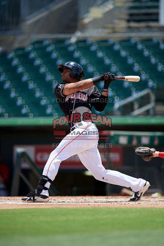 Jupiter Hammerheads third baseman James Nelson (19) follows through on a swing during a game against the Palm Beach Cardinals on August 5, 2018 at Roger Dean Chevrolet Stadium in Jupiter, Florida.  Jupiter defeated Palm Beach 3-0.  (Mike Janes/Four Seam Images)