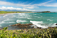 Waves roll in from the Tasman Sea at Tauranga Bay on the rugged West Coast of New Zealand's South Island.