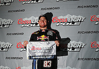 May 1, 2009; Richmond, VA, USA; NASCAR Sprint Cup Series driver Brian Vickers celebrates after winning the pole position for the Russ Friedman 400 at the Richmond International Raceway. Mandatory Credit: Mark J. Rebilas-