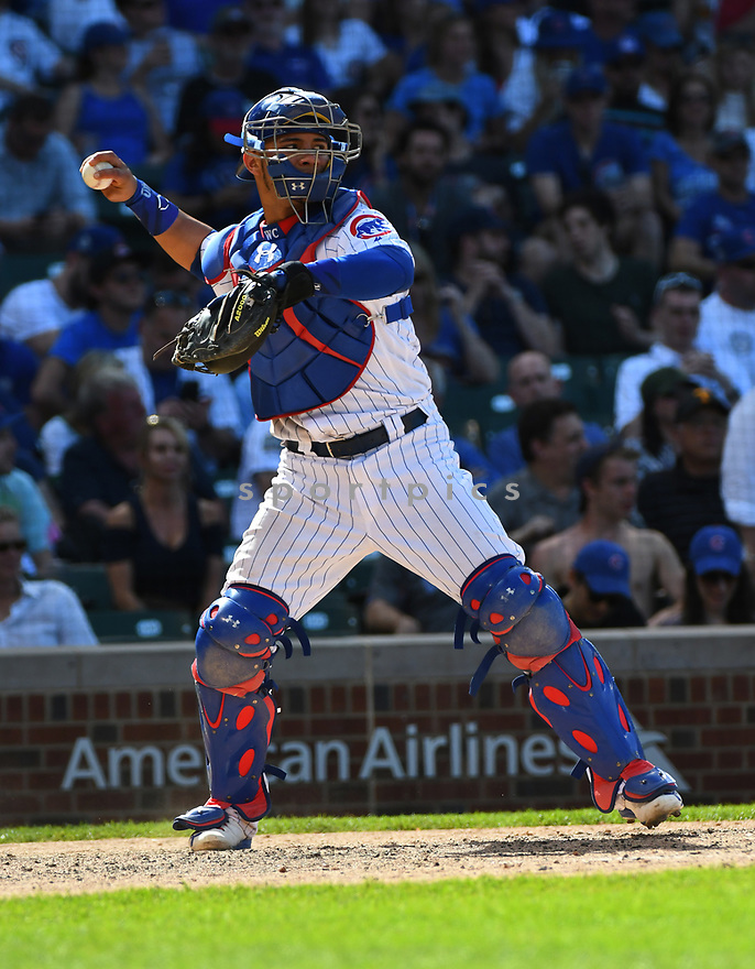 CHICAGO IL - May 18, 2017: Willson Contreras #40 of the Chicago Cubs during a game against the Cincinnati Reds on May 18, 2017 at Wrigley Field in Chicago, IL. The Cubs beat the Reds 9-5.(David Durochik/ SportPics)