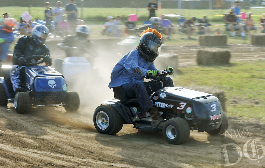 NWA Democrat-Gazette/MICHAEL WOODS • @NWAMICHAELW .... Monte McDonald from Claremore Oklahoma, takes a corner while racing in the 5th annual lawnmower races Saturday evening July 25th in Pea Ridge.  The annual event sponsored by the Pea Ridge Lions Club draws lawnmower racing fans from across the region.