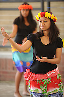 NWA Democrat-Gazette/ANDY SHUPE<br /> Lillian Chonggum of Springdale dances a traditional Marshallese dance Saturday, Sept. 19, 2015, during the Welcoming NWA: Celebrating the Cultural Diversity of Northwest Arkansas event at Shiloh Square in downtown Springdale. The event was organized by Engage NWA, a coalition of nonprofit organizations, businesses and community members, to celebrate National Welcoming Week.