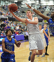 NWA Democrat-Gazette/ANDY SHUPE<br /> Fayetteville guard Tyler Roth (1) reaches to score past Rogers forward A-ron Jones (35) Friday, Feb. 10, 2017, during the first half of play in Bulldog Arena. Visit nwadg.com/photos to see more photographs from the game.