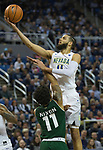 Nevada's Cody Martin shoots a layup over Colorado State's Prentiss Nixon in the second half of an NCAA college basketball game in Reno, Nev., Sunday, Feb. 25, 2018. (AP Photo/Tom R. Smedes)