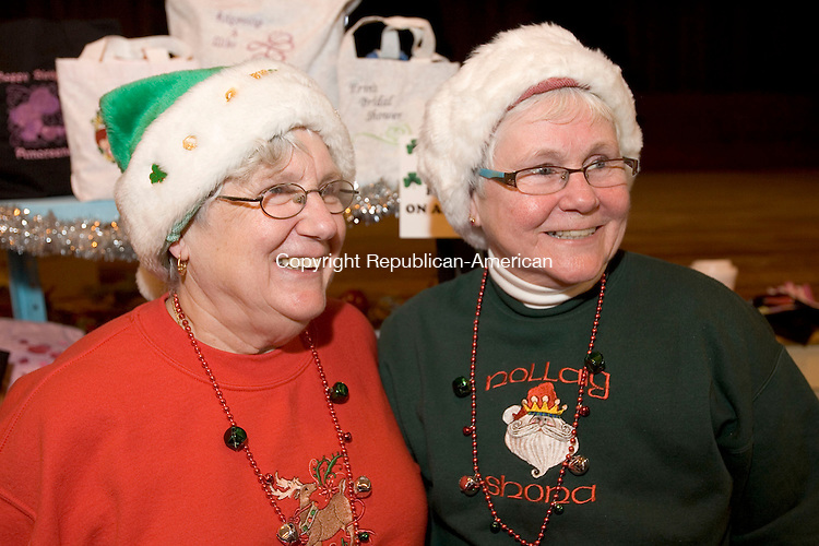 WATERTOWN, CT. 26 November 2011-112611SV02--From left, Leanne Valengavich and her sister Pamela Mangan both of New Britain get into the holiday spirit with festive hats at the 2nd annual Spirit of the Holidays event sponsored by Watertown Recreation in Watertown Saturday.<br /> Steven Valenti Republican-American