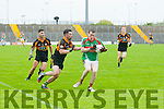 Vinny Casey (St Michaels-Foilmore) in action with Pa McCarthy (Austin Stack) in the Garvey's SuperValu Senior County Football Championship 2015 at Austin Stack Park,Tralee on Saturday evening