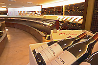 A curved display of bottles. In the foreground bottles of Le Canon SARL La Grande Colline The Lavinia wine shop in Paris. Probably the biggest wine shop in Paris, with its special temperature controlled section for wines that are fragile and must be stored at cool low temperature.