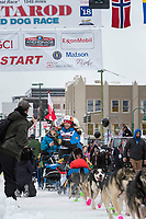 Larry Daugherty and team leave the ceremonial start line with an Iditarider and handler at 4th Avenue and D street in downtown Anchorage, Alaska on Saturday March 3rd during the 2018 Iditarod race. Photo ©2018 by Brendan Smith/SchultzPhoto.com