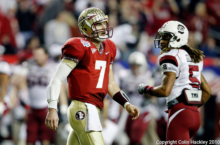 ATLANTA, AG 12/31/10-FSU-SC FB10 CH-Florida State's Christian Ponder leaves the field after his pass fell short on a fourth down conversion as South Carolina's Stephon Gilmore glances at him during first half action Friday at the Chick-fil-A Bowl in Atlanta. Ponder took a hit to the head on the play before and sat out the rest of the game with a concussion..COLIN HACKLEY PHOTO