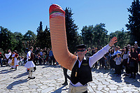 Pictured: A man with a giant penis shaped arm in Tirnavos, central Greece. Monday 11 March 2019<br /> Re: Bourani (or Burani) the infamous annual carnival which dates to 1898 which takes place on the day of (Clean Monday), the first days of Lent in Tirnavos, central Greece, in which men hold phallus shaped objects as scepters in their hands.