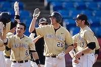 Ryan Semeniuk #26 of the Wake Forest Demon Deacons is congratulated by teammates after hitting a home run against the Xavier Musketeers at Wake Forest Baseball Park March 7, 2010, in Winston-Salem, North Carolina.  Photo by Brian Westerholt / Four Seam Images