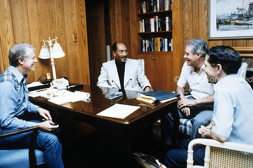 United States President Jimmy Carter, left, meets with President Anwar Sadat of Egypt, left center, U.S. Secretary of State Cyrus Vance, right center, and Osama Al Baz, Ambassador of Egypt to the U.S., right, at Camp David, the presidential retreat near Thurmont, Maryland on September 17, 1978..Credit: White House via CNP
