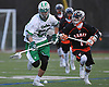Steven Kunz #50 of Farmingdale, left, and Dom Scorcia #1 of Carey chase after a loose ball during a non-league varsity boys lacrosse game at Farmingdale High School on Friday, Apr. 8, 2016.