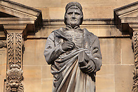 Statue of Jean Froissart, 1333-1400, author, by Henri Lemaire, at the Turgot Wing, in the Cour Napoleon at the Musee du Louvre, Paris, France. A series of 86 statues of famous men were placed in this courtyard 1853-57 under the architects Louis Visconti and Hector Lefuel. Picture by Manuel Cohen