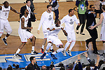 07 APR 2014: Amida Brimah (35) and his University of Connecticut teammates celebrate their win over University of Kentucky in the closing moments during the 2014 NCAA Men's DI Basketball Final Four Championship at AT&T Stadium in Arlington, TX.  Connecticut defeated Kentucky 60-54 to win the national title. Brett Wilhelm/NCAA Photos