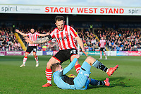 Lincoln City's Neal Eardley wins a free kick from Stevenage's Johnny Hunt<br /> <br /> Photographer Chris Vaughan/CameraSport<br /> <br /> The EFL Sky Bet League Two - Lincoln City v Stevenage - Saturday 16th February 2019 - Sincil Bank - Lincoln<br /> <br /> World Copyright © 2019 CameraSport. All rights reserved. 43 Linden Ave. Countesthorpe. Leicester. England. LE8 5PG - Tel: +44 (0) 116 277 4147 - admin@camerasport.com - www.camerasport.com