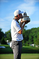 Bethesda, MD - June 29, 2014: Justin Rose kisses the Quicken Loans National trophy after winning the Quicken Loan National at Congressional Country Club in Bethesda MD. The win gives Rose a total of six PGA Tour titles. (Photo by Phillip Peters/Media Images International)