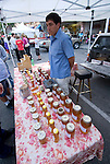 California, San Luis Obispo County: Thursday night festivities in the town of San Luis Obispo, with barbecue and a Farmers' Market.  Honey seller..Photo caluis150-71163..Photo copyright Lee Foster, www.fostertravel.com, 510-549-2202, lee@fostertravel.com