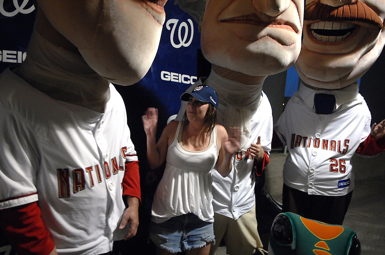 Rep. Rick Renzi, R-Ariz., staffer Nellie Belland, gets nervous about be among the Presidents while having her picture taken with them during the Nationals game at RFK stadium.