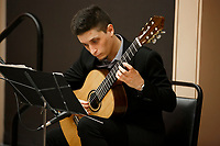 A guitarist performs during the opening reception and dinner of the 11th USA International Harp Competition at Indiana University in Bloomington, Indiana on Wednesday, July 3, 2019. (Photo by James Brosher)