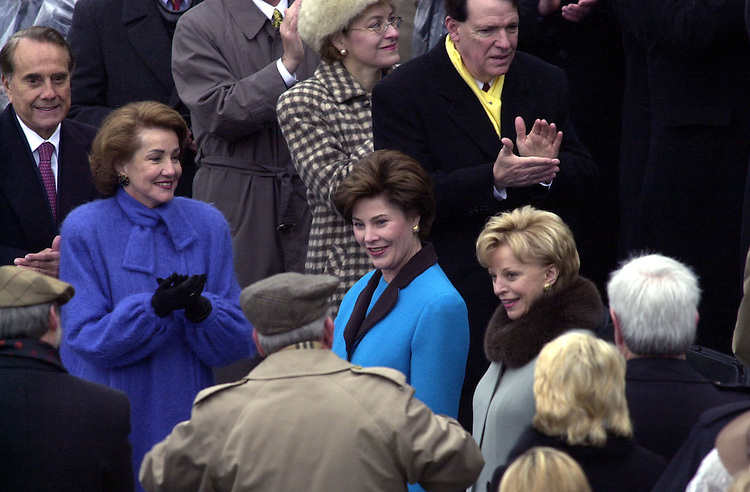 31bush012001 --Laura Bush and ??? Cheney are greeted by members of congressas they arrive for George W. Bush to be sworn in as the 43rd President of the United States.