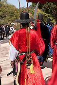 A re-entactment of the Korean royal family and attendants walking through Gyeongbok Palace for the benefit of tourists