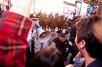 "Police officers threaten protesters with ""Occupy Wall Street"" with arrest at Times Square on October 15, 2011 in New York City.  While crowd estimates numbered in the tens of thousands, police tactics (including nets, motor scooters, barricades, arrests, and intimidation by riders on horseback) prevented the crowd, which had been split up, from joining together as one in the middle of Times Square."