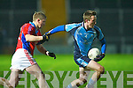 IT Tralee's Mike Frank Russell and Sigerson Cup team's Mike Brosnan in action at Austin Stack park, Tralee on Friday.