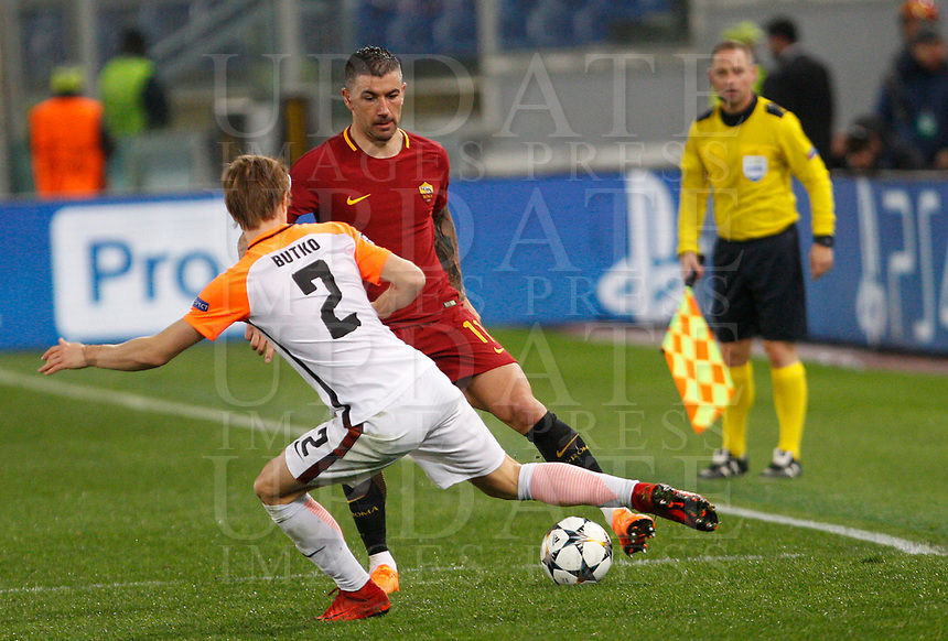 Roma s Aleksandar Kolarov, left, is challenged by Shakhtar Donetsk Bohdan Butko during the Uefa Champions League round of 16 second leg soccer match between Roma and Shakhtar Donetsk at Rome's Olympic stadium, March 13, 2018. Roma won. 1-0 to join the quarter finals.<br /> UPDATE IMAGES PRESS/Riccardo De Luca