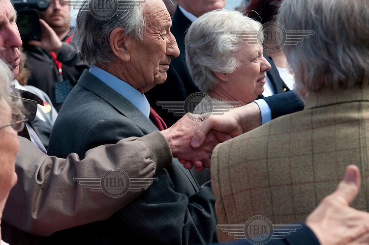 Prime Minister Gordon Brown shakes hands with supporters at a garden party in Weymouth organised by local members of the Labour Party.