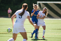 Seattle, WA - Sunday, May 1, 2016: Seattle Reign FC forward Beverly Yanez (17) collides with FC Kansas City midfielder Heather O'Reilly (9) during the first half of a National Women's Soccer League (NWSL) match at Memorial Stadium. Seattle won 1-0.