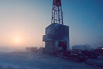 Arctic Oil drilling, Prudhoe Bay, Alaska, North Slope, ARCO oilfields, 1978, difficult working conditions, extreme climate, roustabouts and roughnecks drag and push a rig to a new well
