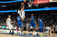 WASHINGTON, DC - FEBRUARY 05: Jagan Mosely #4 and Qudus Wahab #34 of Georgetown of Georgetown go up for  rebound during a game between Seton Hall and Georgetown at Capital One Arena on February 05, 2020 in Washington, DC.
