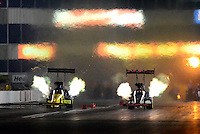 May 18, 2012; Topeka, KS, USA: NHRA top fuel dragster driver J.R. Todd (left) races alongside Steve Torrence during qualifying for the Summer Nationals at Heartland Park Topeka. Mandatory Credit: Mark J. Rebilas-