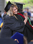 Graduate Denise Rivera hugs Professor Susan Priest during the Western Nevada College commencement at the Pony Express Pavilion, in Carson City, Nev., on Monday, May 19, 2014. <br /> Photo by Cathleen Allison/Nevada Photo Source