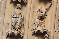 The prophet Joel blowing his trumpet in Sion to announce the coming of the Son of God, on one of the left-hand archivolts of the tympanum of the South portal or St Honore portal on the South transept of the Basilique Cathedrale Notre-Dame d'Amiens or Cathedral Basilica of Our Lady of Amiens, built 1220-70 in Gothic style, Amiens, Picardy, France. St Honore or Honoratus was the 7th bishop of Amiens who lived in the 6th century AD. Amiens Cathedral was listed as a UNESCO World Heritage Site in 1981. Picture by Manuel Cohen