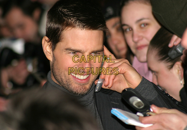TOM CRUISE.The Last Samurai premiere, Odeon Leicester Square.6 January 2004.mobile phone.www.capitalpictures.com.sales@capitalpictures.com.©Capital Pictures