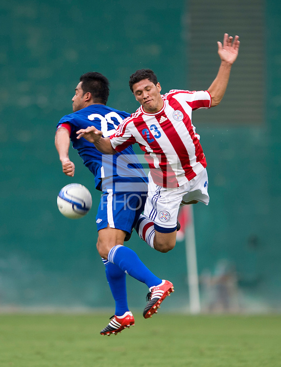Carlos Ruiz (20) of Guatemala collides on a header with Ricard Ortiz (23) of Paraguay during the game at RFK Stadium in Washington, DC.  Guatemala tied Paraguay, 3-3.
