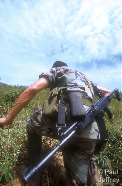 A Colombian soldier climbs through the hills above Cubara in 2010 as part of a force protecting exploratory drilling sites of Occidental Petroleum. The U.S.-based company was drilling on land which U'wa indigenous leaders claimed had bee stolen from their tribal reservation.