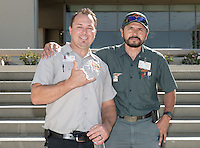 Mike Dorman, left, and Miguel Aguilar. Staff from Facilities Management pose for a group photo outside the AGC Admin. Building, Aug. 17, 2015.<br />