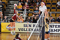 17 November 2011:  Denver outside hitter/defensive specialist Kate Acker (5) hits a kill shot in the fourth set as the FIU Golden Panthers defeated the Denver University Pioneers, 3-1 (25-21, 23-25, 25-21, 25-18), in the first round of the Sun Belt Conference Tournament at U.S Century Bank Arena in Miami, Florida.