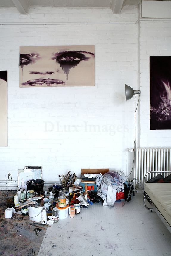Mainly brick walls - all white, no neighbours in sight, a studio full of paintings and a lot of talent compose the artistic loft of Dieter Mammel in Berlin.