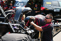 Aug. 1, 2014; Kent, WA, USA; Crew members for NHRA top fuel dragster driver Khalid Albalooshi during qualifying for the Northwest Nationals at Pacific Raceways. Mandatory Credit: Mark J. Rebilas-