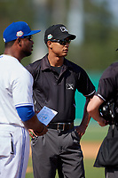 Umpire Hardie Acosta during the lineup exchange before a Florida State League game between the Jupiter Hammerheads  and Dunedin Blue Jays on May 15, 2019 at Jack Russell Memorial Stadium in Clearwater, Florida.  Jupiter defeated Dunedin 5-1 in seven innings, the first game of a doubleheader.  (Mike Janes/Four Seam Images)